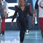 Styling On Them Hoes: Lil Kim In A Black Catsuit & Yellow Michael Antonio Platform Pumps