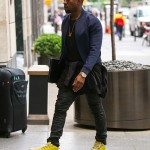 Styling On Them Lames: Kanye West In $545 Yellow Balenciaga Sneakers, Blue Jacket With A Shirt Tied Around His Waist