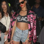 Killing Them Hoes: Rihanna In A Vintage Chanel Chain Print Bomber Jacket & Adidas Jeremy Scott Leopard Sneakers