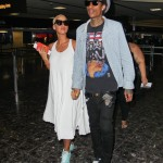 Spotted At the Airport: Is Amber Rose Hiding A Baby Wiz Khalifa Under Her Over-Sized White Dress?