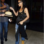 Dope Girl Fresh: Rihanna Wearing Timberland Boots, Rip Jeans & Carrying A Kiss Lock Clutch