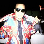 Bringing The 90's Fashion Back: French Montana In A Vintage Versace Silk Shirt & Matching Scarf