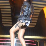 "Good Girl Gone Bad: Rihanna Performing In Nike Air Yeezy II ""Solar Red"" & Fishnet Stocking"