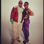 Mixing Up Her Style: Ashanti Wearing A $294 Givenchy Rottweiler Print Jersey Tank Top, Purple Leopard Pants & Black Pumps
