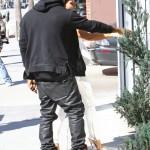 Peep His Style: Kanye West Wears Air Jordan 1s & An $800 Balmain Hoodie
