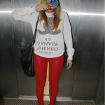 Beyonce Looks Cute In A $65 Criminal Damage Leopard Print White 91 Sweater Paired With Red Pants