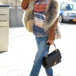 Rihanna Spotted Leaving NYC In A Prada Coat & 1962 Ragtop Impala Crewneck; The Singer Is Back To Long Hair