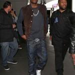 "Meek Mill Wears A $1,195 Gucci Suede Front Jersey Varsity Bomber Jacket, $350 Gucci Belt & Air Jordan Retro 5 ""Fire Red"""