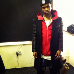 Big Sean Wears A Katie Eary Red Hoodie & A Black Leather Sleeve Coat From The Brand's Fall/Winter 2013 Collection