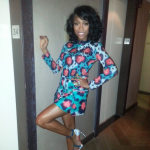 Are You Feeling It? Brandy Wears A $582 Kenzo Embellished Cardigan With The Matching $644 Printed Mini Skirt