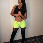 Evelyn Lozada Shows Off Her Abs In Neon Booty Shorts, Garter Tights & Christian Louboutin Boots