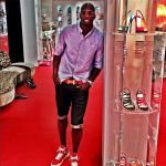 Chad Ochocinco Shops It Up At Christian Louboutin In Givenchy Star Studded Leather High Top Sneakers
