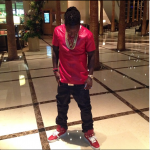 Ace Hood Sporting $627 Givenchy Star Studded Leather High Top Sneakers & A $460 Red Leather V-Neck By PRSVR