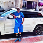 T.I. Rocks An Akoo Tee-Shirt, Cargo Shorts & $505 Maison Martin Margiela Sneakers