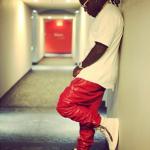 Ace Hood Styles In $560 PRSVR Luxury Red Track Pants & $875 Giuseppe Zanotti Sneakers