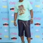 Nelly Rocks A Custom Pair Of Rainbow Nike Air Foamposite & PRSVR Leather Shorts