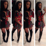 Draya Wears A $508 Givenchy Floral Gangsta Madonna Print Tee-Shirt & $1,990 Tom Ford Zipper-Heel Over-the-Knee Leather Boots