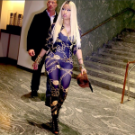 Nicki Minaj Styles A Chain-Printed Jumpsuit & Jacket From Her Clothing Line With $1,495 Giuseppe Zanotti Pyramid Stud Lace-Up Booties