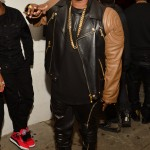Rico Love Pairs A $5,695 Versace Black & Brown Quilted Leather Jacket With Giuseppe Zanotti Sneakers