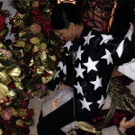 She's In The Holiday Spirit: Rihanna Photo'd In Front Of A Christmas Tree In A $308 Joyrich All Star Patched Jacket