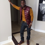 Kevin Hart Wears A $550 Moncler Burgundy Down Tib Puffer Vest & $575 Balenciaga Arena Sneakers