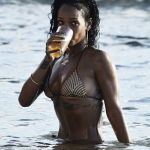 Rihanna Continues Holiday Vacay In Barbados; Spotted Jet Skiing, Swimming & Rolling In The Sand