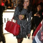 Angela Yee Carries A $2,695 Saint Laurent Cabas Classique Y Medium Leather Tote & Wears $1,995 Christian Louboutin Bandita Boots