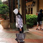 Toya Wright Wears $690 Prada Suede Wedge Sneakers & Carries A $1,995 Prada Glacé Calf Small Twin Pocket Tote