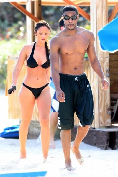 Actor Michael B. Jordan and a female friend wearing a black bikini, jet ski at Soho House in Miami Beach, Florida