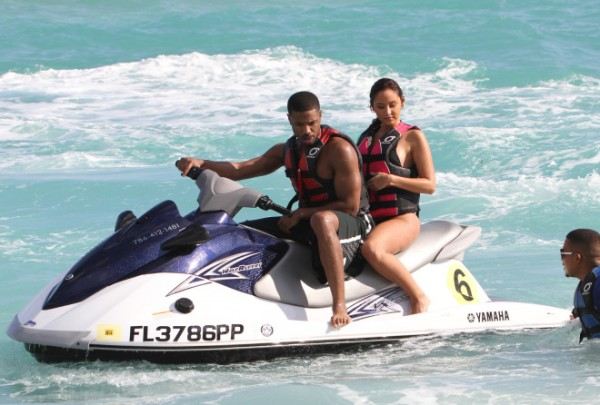 Michael B. Jordan with a beautiful mystery brunette riding a jet ski in Miami Beach