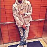 Spenzo Wears A $2,250 3.1 Phillip Lim Padded Motorcycle Jacket & $990 Givenchy White Matte Leather Gold-Plated Sneakers