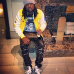 Wale Wearing A $464 Milo x The Simpsons Sweat Varsity Jacket & Saint Laurent Leather Biker Pants