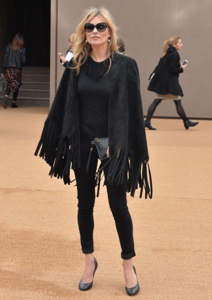 Kate Moss attends the Burberry Prorsum Womenswear Autumn/Winter 2015 Fashion Show at Perks Field, Kensington Gardens in London