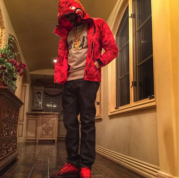 3172700dc605 Philly s own and MMG Atlantic Records recording artist Meek Mill styled a  Bape A Bathing Ape Shark Snowboard Camo Red Jacket over a Puma sweatshirt  with ...