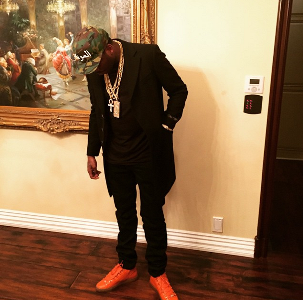00215794e5c26 Meek Mill Spotted In A Pair Of Orange Balenciaga Arena Creased ...