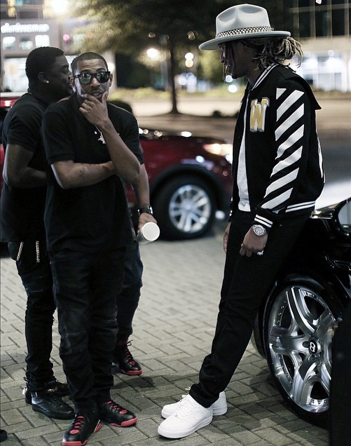 fa2011661dd8 Rapper Future was photo d sitting on the back of an all-black Bentley in a   1