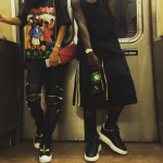 Teyana Taylor Spotted On The NYC Subway In $1,590 Saint Laurent 15cm Skinny Stretch Cotton Denim Biker & $600 Fendi Leather Monster Skate Sneakers