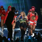 Lil Kim Performs In A $2,245 Versace '#Greek' Cropped Jacket