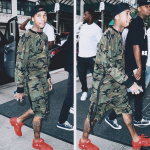Tyga Spotted In A Daniel Patrick Strap Hero Sweat ii, Matching Strap Roaming Shorts iii & Adidas By Raf Simons Red 'Ozweego 2' Sneakers