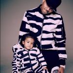 Chris Brown Wears A $1,495 Moschino Logo Print Bomber Jacket
