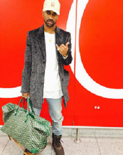 7fac779bbbf48 Big Sean Wears Another Pair Of YEEZY Season 1 Yeezy 950 Boots  Plus He  Carries A Green Goyard Duffle Bag