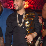 Rapper French Montana Parties In A Moschino Gold Logo Long-Sleeve Shirt