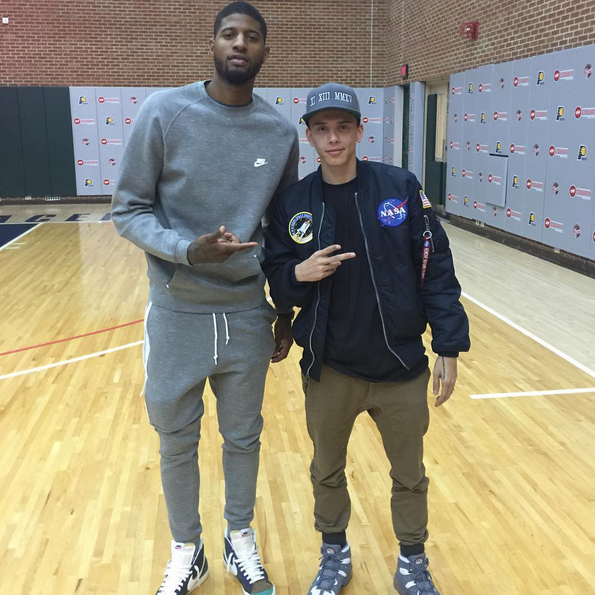 61a65ffbac1 Paul George of the Indiana Pacers kept it casual in a grey Nike sweater  sweatsuit and blazers sneakers from the brand.