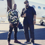 Kevin Hart Wears A Valentino 'Rockstud' camouflage Sweater & Balenciaga Paneled High-Top Sneakers In Burgundy On A Private Jet