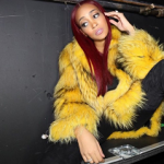 Monica Brown Wears A Yellow Fur Coat From Helen Yarmak