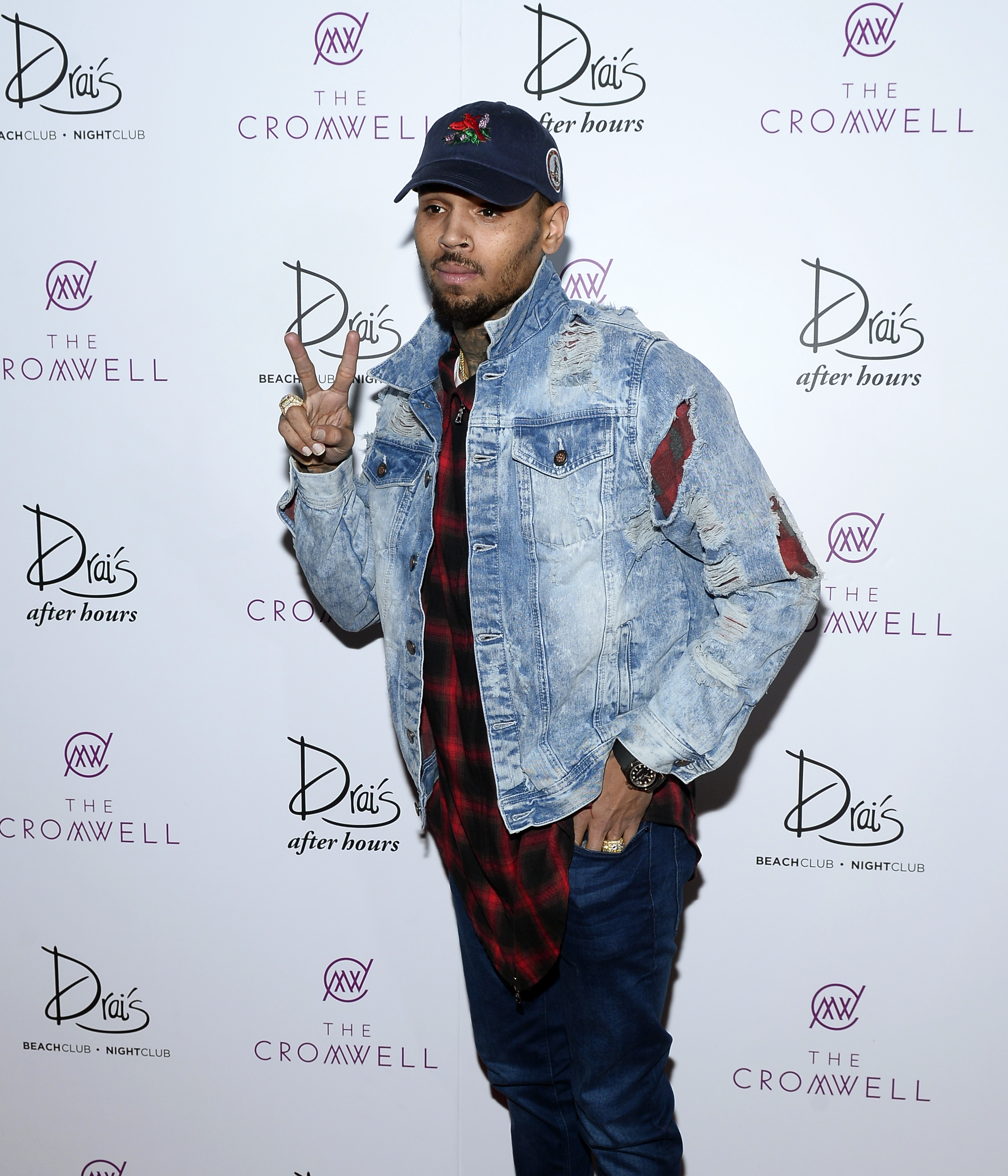 ad6cc45ad1308b ... Chris Brown Wears A Rabbit   Couth Distressed Denim Jacket At Drai s ...