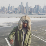 Diggy Simmons Outfitted In A Mr & Mrs Italty Army Parka Patch Coyote And 3.1 Phillip Lim Sweatshirt