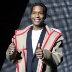 Paris Fashion Week: A$AP Rocky Attends Dior Homme Fall/Winter 2016 Menswear Show In A Coat From The Brand
