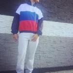 Diggy Simmons Wears A Gosha Rubchinskiy Navy & Tricolor Zip Collar Sport Jacket