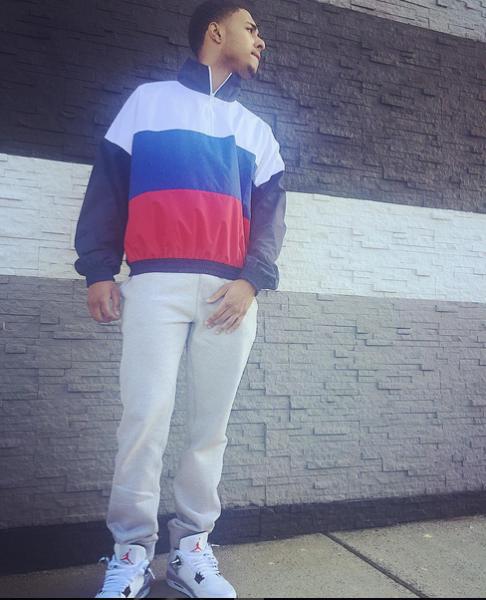f9e1ff7622a617 ... Diggy Simmons Wears A Gosha Rubchinskiy Navy   Tricolor Zip Collar Sport  Jacket